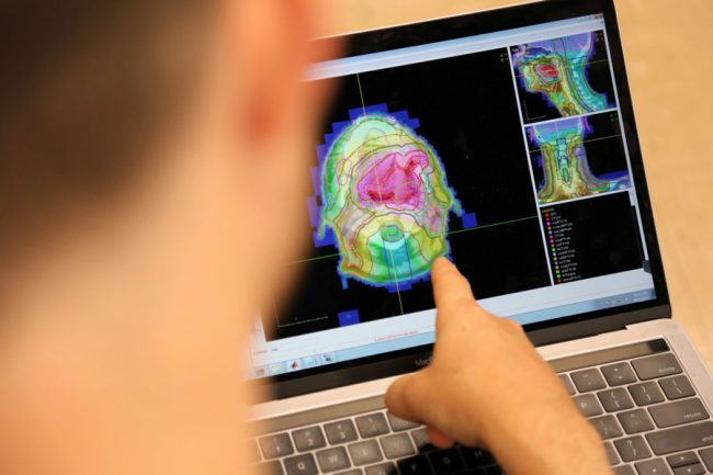 Aaron Babier (MIE PhD candidate) is using AI technology to automate radiation therapy planning. (Photo: Brian Tran)